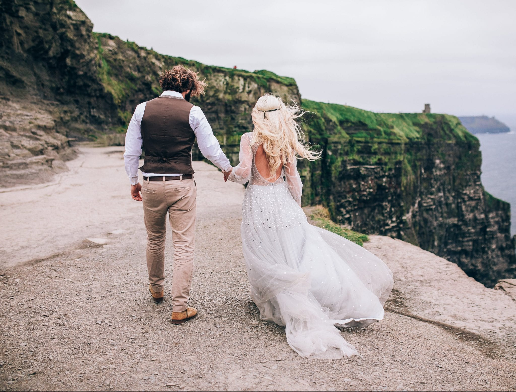Couple walking during their intimate Wedding in Ireland at the Cliffs of Moher