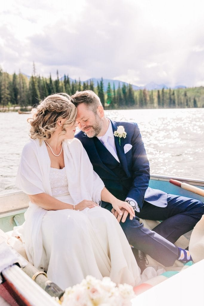 Just married couple in Jasper going  on a boat ride taking photos