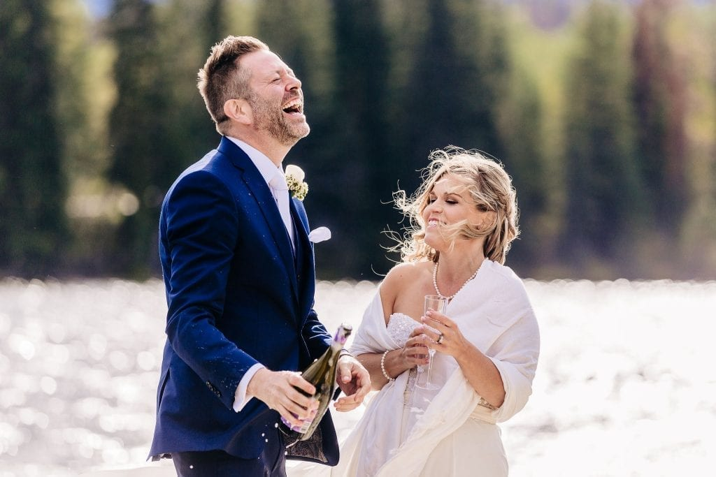 Bride and Groom celebrating after their ceremony on pyramid lake Jasper