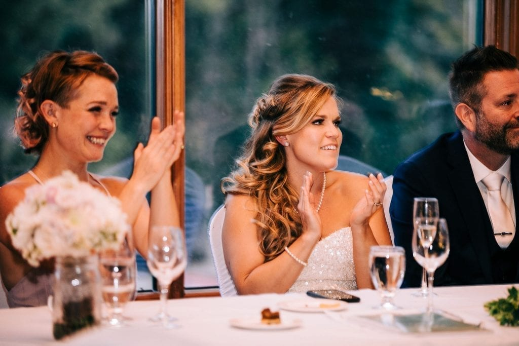 Happy bride clapping after her dad's speech at her wedding day in Jasper