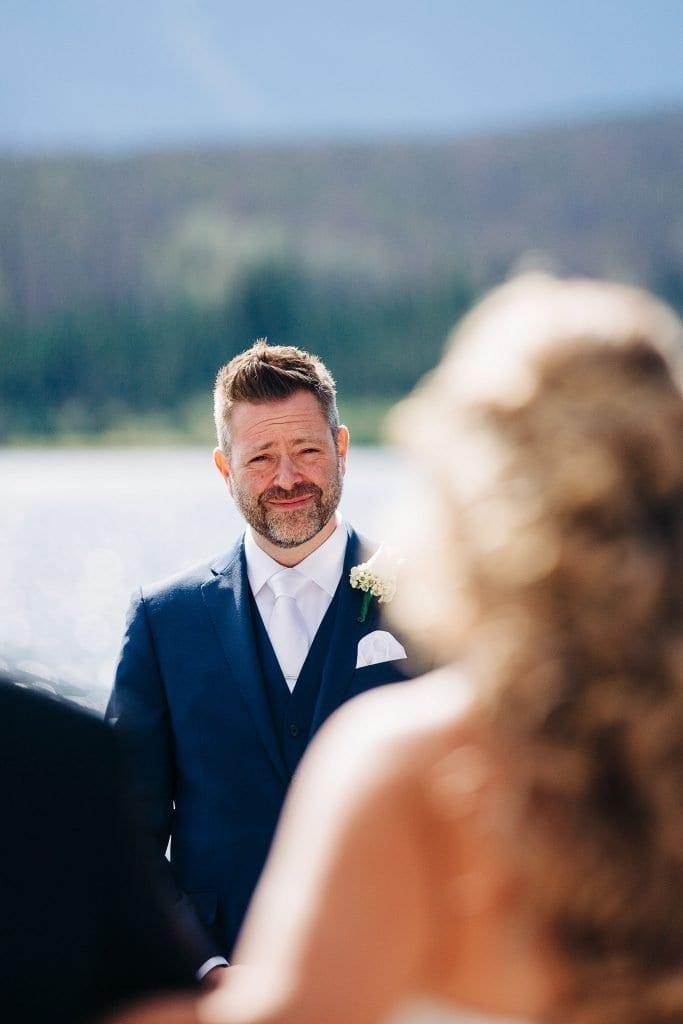 groom watching her bride walk to him with her dad