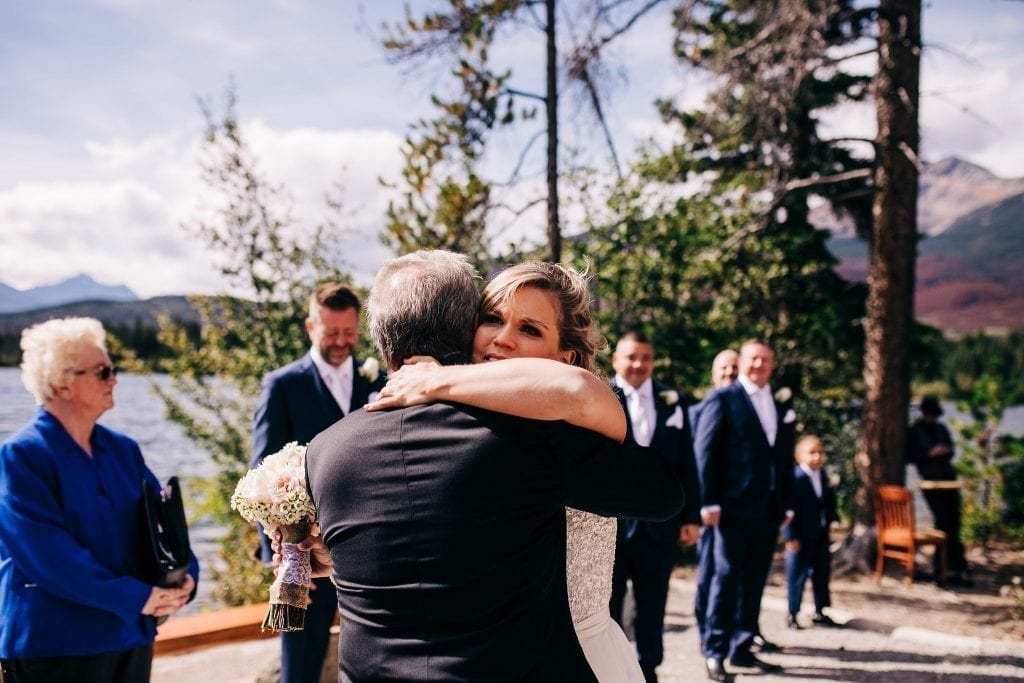 Bride hugging her dad as he guves her away to her future husband on Pyramid Lake
