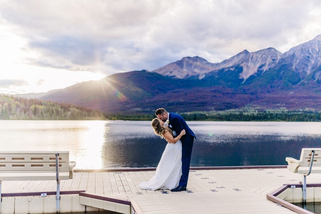 Bride and Groom Kissing at Sunset in jasper