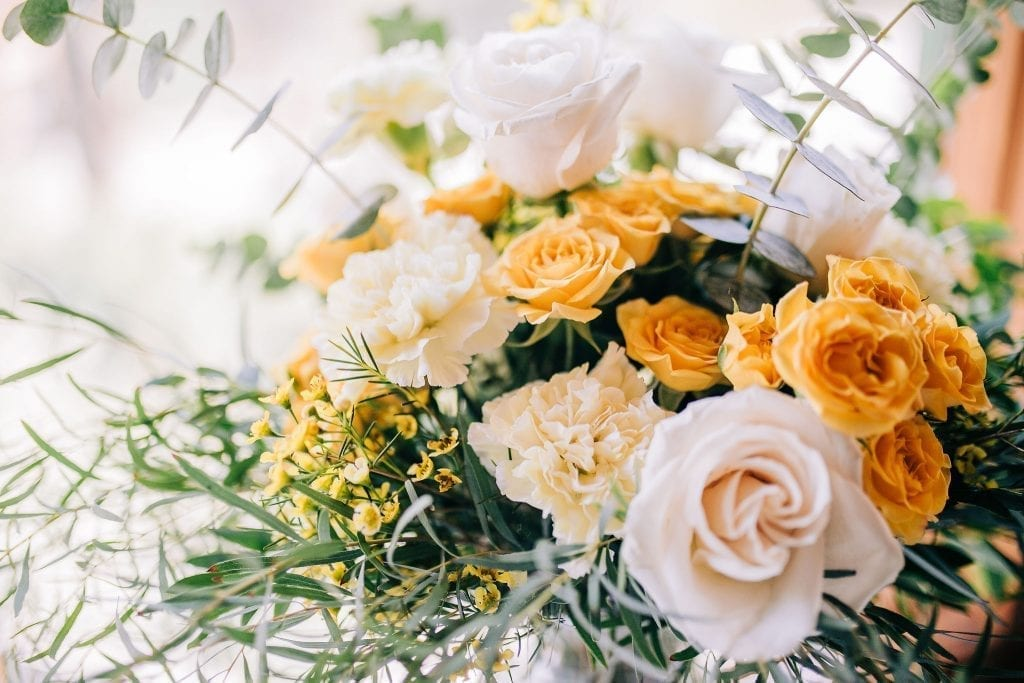 stunning flowers and centrepieces  in Peach, yellow and white plus greenery wedding inspiration