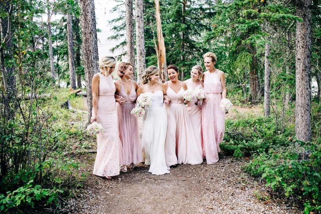 The bride and her girls in amazing all different pink gowns