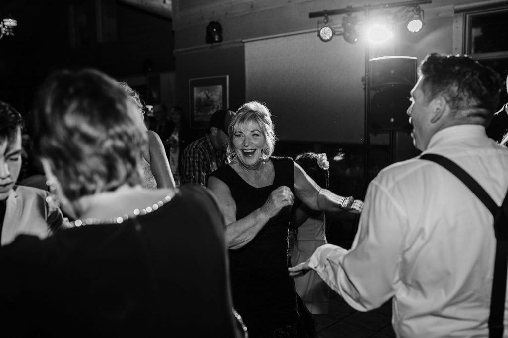 Mom of the groom dances during this Jasper Wedding reception photos