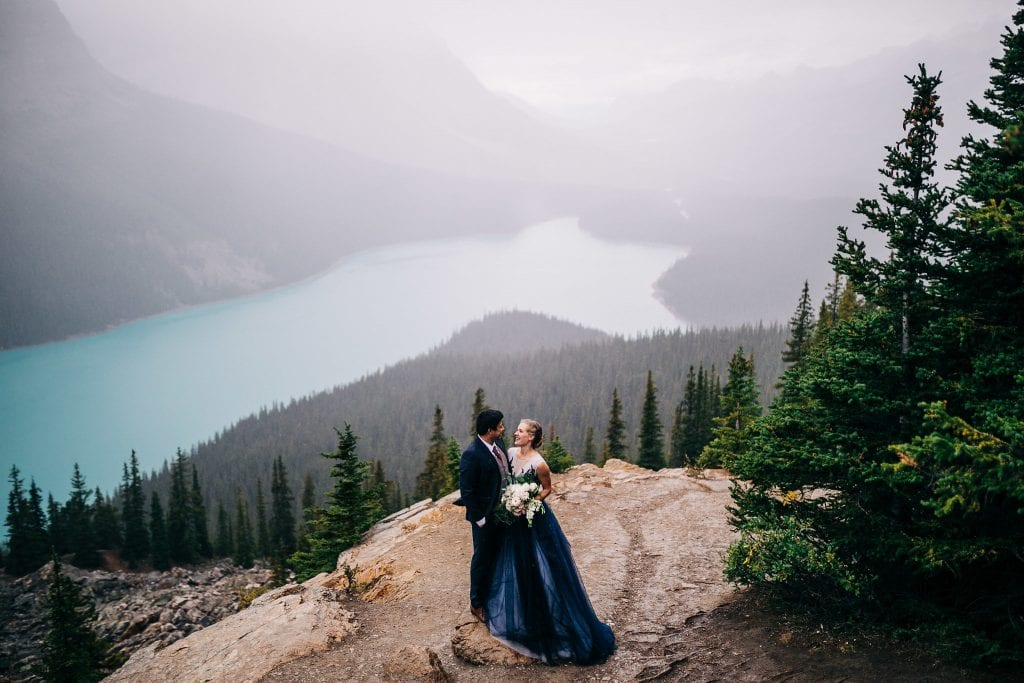 Couple eloping in the Rocky Mountains in a blue dress